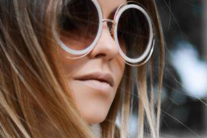 girl wearing designer sunglasses